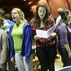 ALLEGRA BOVERMAN/Staff photo. Gloucester Daily Times. Rockport: Members of the Rockport High School Madrigals perform for their peers during the Chorus Summit on Tuesday afternoon at the performing arts center. The Chorus Summit was convened to bring the Madrigals, the high school, middle school and elementary school choruses together for fellowship, mentoring and love of singing. From left are sophomore Danielle Pool, freshman Isabelle Brisson, senior Emily Good and juniors Jenny Sonia and Renee Waller.