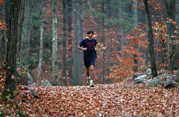 ALLEGRA BOVERMAN/Staff photo. Gloucester Daily Times. Gloucester: Noah Mondello of the Gloucester High School cross-country team, preparing in Ravenswood Park, for the All-State meet this Saturday.