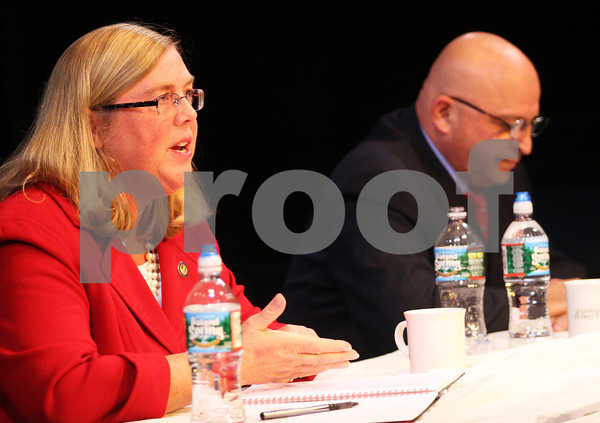 ALLEGRA BOVERMAN/Staff photo. Gloucester Daily Times. Gloucester: Gloucester Mayor and mayoral candidate Carolyn Kirk, left, and Ken Sarofeen during their debate on Wednesday held at the Gloucester Stage Company.