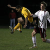 ALLEGRA BOVERMAN/Staff photo. Gloucester Daily Times. Rockport: Rockport's Chandler Burnham, right, in action against Boston International in Rockport on Monday night. Rockport won 4-1.