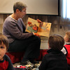 Tommy Dort, 3, of Gloucester, visits the Preschool Story Hour at the Rockport Public Library, but is destracted from the book volunteer reader Linda Teahen reads aloud Tuesday morning. Jesse Poole/Gloucester Daily Times Nov. 1, 2011