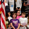 "ALLEGRA BOVERMAN/Staff photo. Gloucester Daily Times. Gloucester: Students sang several patriotic songs such as ""Bless Our Troops,"" ""America the Beautiful,"" and the Star Spangled Banner during their Veterans Day ceremony held at Veterans Memorial School on Wednesday afternoon. A poem titled ""Veterans Day,"" by Cheryl Dyson, was also read by student Kayla Pennimpede."