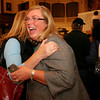 ALLEGRA BOVERMAN/Staff photo. Gloucester Daily Times. Gloucester: Carolyn Kirk won again as Gloucester's mayor. She is hugged by friend Julia Bishop, left, at City Hall as the results came in on Election Night.