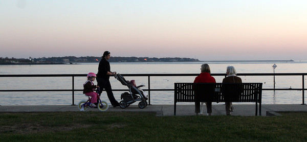 ALLEGRA BOVERMAN/Staff photo. Gloucester Daily Times. Gloucester: Members of the Klopotoski family of Gloucester stroll and cycle along Stacy Boulevard on Tuesday afternoon. On her bike is Kassidy, 3, with her mom Jenn and baby sister Karsyn, seven months old.