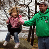 GLOUCESTER—Alyssa Hering, of Beverly, enjoys being pushed on a swing by her dad, Jim Hering, at the Stage Fort Park playground on Wednesday morning. Jesse Poole/Gloucester Daily Times Nov. 16, 2011