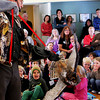 Mark Wilson of Eyes on Owls reveals the Barred Owl to children and adults who gathered at the Manchester Community Center on Thursday morning. Jesse Poole/Gloucester Daily Times Nov. 3, 2011