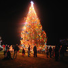 Desi Smith/Gloucester Daily Times. Gloucester: People gather around the Christmas Tree all lit up at Kent Circle late Sunday afternoon,  November 27, 2011.