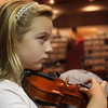 "Lucy Twombly, third grade, picks on her violin to contribute to the Edgar Allen Poe inspired tunes that strings teacher Nathan Cohen, has the students play at the ""Orchestra Summit"" in the Performing Arts Center at Rockport Public High School on Wednesday afternoon. Jesse Poole/Gloucester Daily Times Nov. 2, 2011"