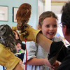 Bridget, a student of Tara Montessori School in Manchester, is about to attempt to make the hooting noise of an Eastern Screech Owl for the adults and children who've gathered at the Manchester Community Center on Thursday morning to see Mark Wilson of Eyes on Owls display various types of owls. Jesse Poole/Gloucester Daily Times Nov. 3, 2011