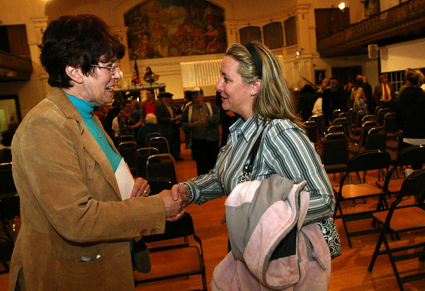 ALLEGRA BOVERMAN/Staff photo. Gloucester Daily Times. Gloucester: Melissa Cox, right, won the Ward 2 seat over Ann Mulcahey, left. They shake hands after the votes were tallied at City Hall on Election Night.