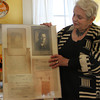 Joan Roberts of Rockport stands in her home and holds up a picture of her late uncle, Eugene Eberhardt, a Machinist's Mate First Class in the US Navy, who perished on the USS Oaklahoma when it sank at Pearl Harbor during WWII. She is waiting for the Navy to identify Eberhardt's body, which was buried in a mass grave at the end of 1942. Jesse Poole/Gloucester Daily Times Nov. 9, 2011