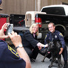 "Gloucester Police Chief Mike Lane takes a photo of Mayor Carolyn Kirk with the new K9 Unit: Chris Genovese and Mako, a Belgian Malmois. This pair creates the first K9 Unit of the Gloucester Police Department in its history. After typing out a seven-page report on his own, unpaid time, Genovese made a bid for the new canine addition, which will greatly improve the department's tracking and searching for illegal articles, such as illegal drugs. Genovese received the go-ahead from Chief Mike Lane and full support by Mayor Carolyn Kirk. ""He's a thousand times better at smelling than humans,"" said Genovese on Thursday afternoon as he introduced Mako to Kirk. Currently, Mako is in a 14 week training academy, and will eventually be trained to track narcotics. Mako will only cost the police department $1 to $1.50 per hour, after start-up costs. A deal deal for the department, said Lane."