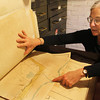 Sarah Dunlap, co-chair of the Gloucester Archives Committee, shuffles through a stack of historic maps to find an old planning map of the boulevard along Western Avenue. Jesse Poole/Gloucester Daily Times Nov. 7, 2011