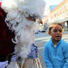 ALLEGRA BOVERMAN/Staff photo. Gloucester Daily Times. Gloucester: Marley Castillo, 4, of Gloucester, right, tells Santa Claus what she'd like for Christmas, along Main Street in Gloucester on Friday morning while shopping with her family.