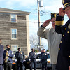 Police Cheif Mike Lane stands by his father, Leland Lane, a WWII veteran, as they salute after placing a reath down at the Joan of Arc statue to commemorate America's veteran soldiers on Friday morning. Jesse Poole/Gloucester Daily Times Nov. 11, 2011 leland