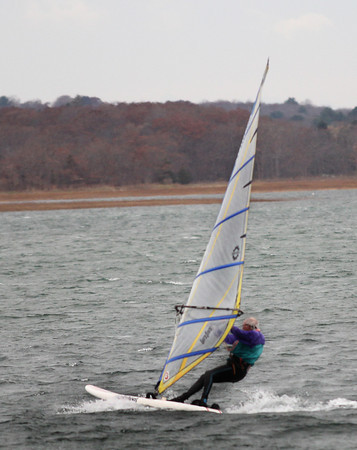 Essex—Paul Weingartner of Beverly visits the waters off Conomo Point on Tuesday afternoon to do what he loves to do and what he's been doing since 1978: wind surf. His plans were to circle Choate Island in the strong winds. Jesse Poole/Gloucester Daily Times Nov. 15, 2011