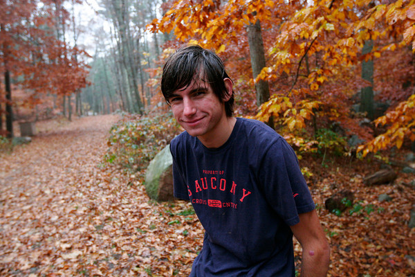 ALLEGRA BOVERMAN/Staff photo. Gloucester Daily Times. Gloucester: Noah Mondello, of the Gloucester High cross-country team, preparing, in Ravenswood Park, for the All-State meet this Saturday.
