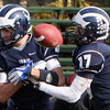ALLEGRA BOVERMAN/Staff photo. Gloucester Daily Times. Swampscott: Swampscott's Aaron Cronin, left, and Richard Sullivan both fumble the ball during their game against Gloucester on Saturday in Swampscott.