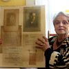 Joan Roberts of Rockport sits in her home and holds up a picture of her late uncle, Eugene Eberhardt, a Machinist's Mate First Class in the US Navy, who perished on the USS Oaklahoma when it sank at Pearl Harbor during WWII. She is waiting for the Navy to identify Eberhardt's body, which was buried in a mass grave at the end of 1942. Jesse Poole/Gloucester Daily Times Nov. 9, 2011