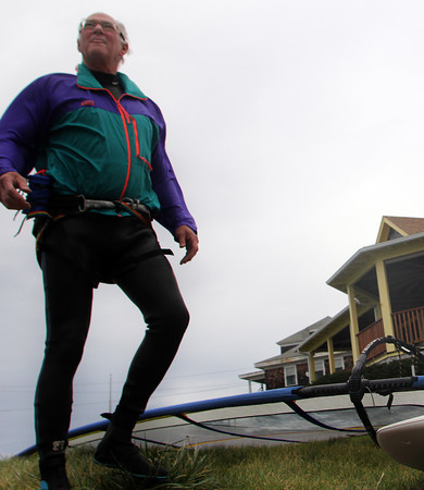 Essex—Paul Weingartner of Beverly visits Conomo Point on Tuesday afternoon to do what he loves to do and what he's been doing since 1978: wind surfing. His plans were to circle Choate Island in the strong winds. Jesse Poole/Gloucester Daily Times Nov. 15, 2011