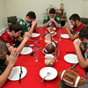 ALLEGRA BOVERMAN/Staff photo. Gloucester Daily Times. Gloucester: Thanksgiving is for turkey and football. Clockwise from lower left are Manchester Essex's Joe Burgess, Gloucester's Nick Taormina, Manchester Essex's Paul Pennoyer and Cooper Riehl, Gloucester's Kyle Lucido and Manchester Essex's Mavrick MacEachearn.