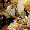 ALLEGRA BOVERMAN/Staff photo. Gloucester Daily Times. Gloucester:John Pasierbiak, left, and Matt Dow, both American Legion members and volunteers, have been busy preparing lots of turkeys in advance of Thanksgiving on Wednesday afternoon. By 3 p.m. they had made 15 turkeys, each weighing about 22 pounds. The American Legion hosts an annual dinner on Thanksgiving which is free and open to the public at their hall on Washington Street, and pack up and deliver hundreds of full meals to people in the area.