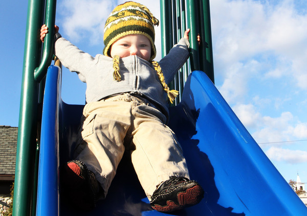 Keegan Kock, 2, of Gloucester, prepares himself for the rush of a slide at Shepard's Memorial Park in Essex on Friday afternoon. Jesse Poole/Gloucester Daily Times Nov. 4, 2011