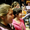 ALLEGRA BOVERMAN/Staff photo. Gloucester Daily Times. Rockport: During the Chorus Summit on Tuesday afternoon at the performing arts center. The Chorus Summit was convened to bring the Madrigals, the high school, middle school and elementary school choruses together for fellowship, mentoring and love of singing. From left are fifth graders Ali Ketchopulos, Juliana Silva and senior Victoria Oulton.