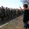 Markus Silva, 6, and his twin sister Lindzy, march in place as ROTC members of Gloucester High School march down Western Avenue as part of the Veterans' Day parade on Friday morning. Jesse Poole/Gloucester Daily Times Nov. 11, 2011