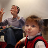 Caroline Campbell, 2, of Rockport, enjoys wriggling around and listening to Linda Teahen as she reads a childrens book and counts 10 monkeys on her hands on Tuesday morning during Preschool Story Hour at the Rockport Public Library. Jesse Poole/Gloucester Daily Times Nov. 1, 2011