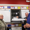 ALLEGRA BOVERMAN/Staff photo. Gloucester Daily Times. Gloucester: Sears employee Dan Kariores, right, helps Frank and Carol Gray of Rockport with purchasing a new dishwasher at Sears on Friday morning at the Gloucester store.