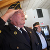 ALLEGRA BOVERMAN/Staff photo. Gloucester Daily Times. Manchester: The American Legion Post 113 held its Veterans Day ceremony at its headquarters on Friday morning and also held a flag burning ceremony to properly retire old flags. Also on hand was the trio Purpose from Lynn. Legion members Tom Cockfield, left, and Paul Sullivan were among the veterans, along with family and friends, on hand for the ceremonies.