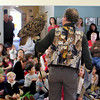 Mark Wilson of Eyes on Owls faces the crowd at the Manchester Community Center to reveal the greatness of the largest of owls, the Eurasian Eagle Owl. Jesse Poole/Gloucester Daily Times Nov. 3, 2011