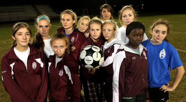 ALLEGRA BOVERMAN/Staff photo. Gloucester Daily Times. Gloucester: The Gloucester girls varsity soccer team midfield.
