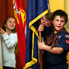 "ALLEGRA BOVERMAN/Staff photo. Gloucester Daily Times. Gloucester: <br /> From left: Veterans Memorial School fourth graders Brianna Alves, carrying a Coast Guard flag, Steven Strong carrying a Marines flag and Brett Cagney, carrying a Navy flag, during the singing of Salute to the Arms Services medley of songs at the Veterans Day ceremony held at the school on Wednesday afternoon. Alves is a Girl Scout and the boys are members of Boy Scout Troop 112. Students sang patriotic songs such as ""Bless Our Troops,"" ""America the Beautiful,"" and the Star Spangled Banner. A poem titled ""Veterans Day,"" by Cheryl Dyson, was read by student Kayla Pennimpede."