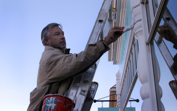 Carl Oulton, owner of Just Call the Guy, a local paint contraining company, stands on his ladder to touch-up-paint the exterior of Thistle Hill on Upper Main Street in Rockport. Jesse Poole/Gloucester Daily Times Nov. 4, 2011