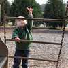 Sebastian Preas, nearly 3, looks to climb a chain ladder at Shepard Memorial Park's playground in Essex on Tuesday afternoon. Jesse Poole/Gloucester Daily Times Nov. 1, 2011