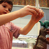 ESSEX—A giant to the giants, Charlie Falk, a Kindergartener at Essex Elementary School, plays with dinosaurs with his friends on Thursday afternoon. Jesse Poole/Gloucester Daily Times Nov. 17, 2011