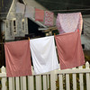 ALLEGRA BOVERMAN/Staff photo. Gloucester Daily Times. Gloucester: Laundry dries on lines along the backyards of Elizabeth Road in Gloucester on a mild Monday afternoon.
