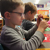 George Mullin uses a stencil to create his artistic array of shapes with other kindergarteners at Essex Elementary School on Tuesday afternoon. Jesse Poole/Gloucester Daily Times Nov. 1, 2011