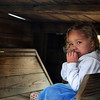 GLOUCESTER—Sammy Walker, 2, of Magnolia, pretends she's in a kitchen at the Stage Fort Park playground on Wednesday morning, and as she eats imaginary chicken nuggets, she's weary of visitors because she might not have enough food to share. Jesse Poole/Gloucester Daily Times Nov. 16, 2011