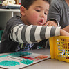 "Logan Desouza, 5, looks for the right color marker as he draws during ""free play"" with his kindergarten classmate at Essex Elementary School on Tuesday afternoon. Jesse Poole/Gloucester Daily Times Nov. 1, 2011"