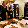 Jennifer Goulart Amero and her daughter, Julia, who joined her in the voting stall, register with electioneer Gerry Noble Cronin after casting a vote for the Ward 2 councilor and other city positions at McPherson Park on Tuesday afternoon. Jesse Poole/Gloucester Daily Times Nov. 8, 2011