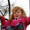 Lizzie Sly, 4, of Rockport, prepares herself to slip down a slide at the Stage Fort Park playground on Wednesday morning. Jesse Poole/Gloucester Daily Times Nov. 16, 2011