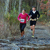 Courtesy Photo/Gloucester Daily Times. Gloucester:Jenn Brooks exits the woods for the final half-mile of the 50-mile Stone Cat ultramarathon. Brooks was the only Cape Ann resident to complete this year's ultramarathon. Sean McKay, who accompanied Brooks the last 12 miles, provides encouragement.