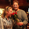 After Melissa Cox was elected Ward 2 councilor, she and her husband, Bill, visited The Pub at Cape Ann Brewery, where Bill pulled roses out from behind his back to surprise her in celebration. Jesse Poole/Gloucester Daily Times Nov. 8, 2011