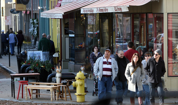 ALLEGRA BOVERMAN/Staff photo. Gloucester Daily Times. Gloucester: Shoppers stroll downtown in Gloucester on Friday.