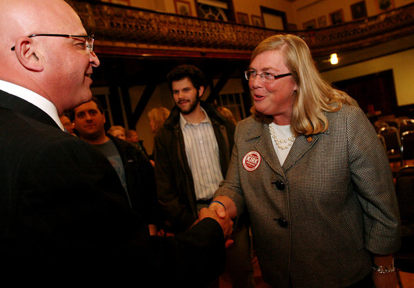 ALLEGRA BOVERMAN/Staff photo. Gloucester Daily Times. Gloucester: Carolyn Kirk won again as Gloucester's mayor, right. She shakes hands with rival Ken Sarafeen.