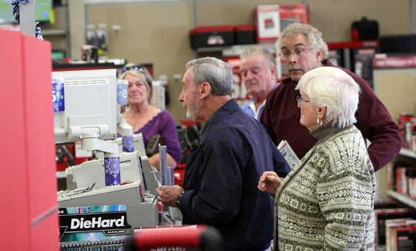 ALLEGRA BOVERMAN/Staff photo. Gloucester Daily Times. Gloucester: Shoppers, including Frank and Carol Gray of Rockport, front, at Sears on Friday morning.