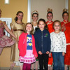 Courtesy photo/Gloucester Daily Times. Manchester:   Northeast Youth Ballet performing for  Manchester Memorial Elementary School students recently at the Manchester Essex High School. From left in the front row are second graders Callie Perkins, Ainsley Tully and Carter Lockwood. In back are dancers Danielle Valdez, Serena Bourque, Jessica Griffin, Anna Whalen, Ellen Dudley and Hannah Wells. The dancers performed an abridged version of The Nutcracker and then held a question and answer session with the younger pupils.